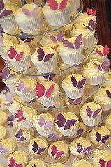 Fluttering butterfly cupcake tower (The Cupcake Studio) Tags: pink wedding tower rose cake butterfly purple cupcake swirl
