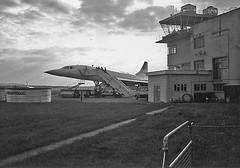 Baby comes home (mono) (stephen_dedalus) Tags: blackandwhite film 35mm aircraft concorde pentacon praktica farnborough aeroplanes 50mmf18 supertl3