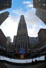 High Rise (silverlily) Tags: nyc newyorkcity usa newyork art statue architecture bronze america buildings nikon manhattan rockefellercenter icerink fisheye gild highrise rockefeller prometheus gebuilding 105mm paulmansh