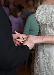 Holding hands & exchanging vows together