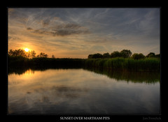 Sunset Over Martham Pits (Jon Frosdick) Tags: uk sunset england sky reflection water pits clouds reeds evening fishing fisherman norfolk hdr broads martham canonefs1755mmf28isusm canoneos40d