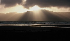 Sun through clouds (chris.bryant) Tags: ocean sunset sea newzealand sky sun sol beach clouds atardecer sand afternoon northisland rays 1001nights magicmoments sunbeams kapitiisland potofgold movingwater abigfave qualitypixels