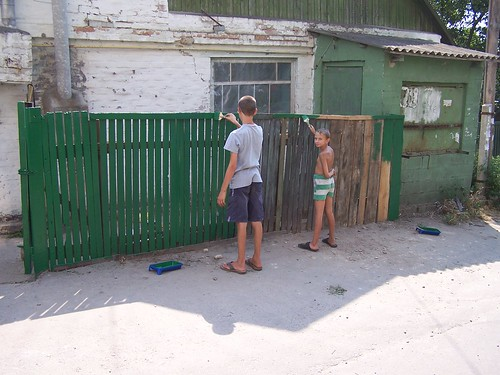 Dominic and Maxime painting the fence