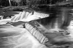 Bond  Falls (James Marvin Phelps) Tags: blackandwhite outdoors photography waterfall michigan falls upper waterfalls peninsula jmp bondfalls mandj98 jamesmarvinphelps bondfallsscenicsite watersmeetmichigan