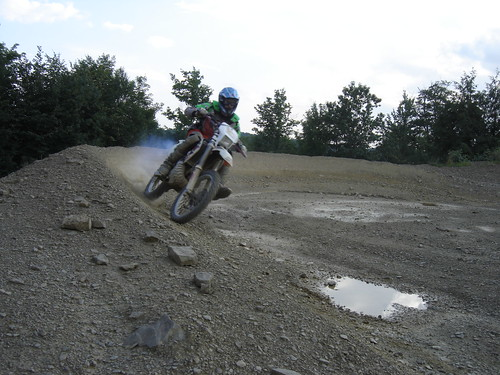 ktm 300 coming out of a berm