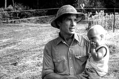 Farmer and Child (nosha) Tags: bw usa baby man hat newjersey nikon infant farm north nj september eat 200 local farmer organic 18 pm 2008 hopewell 18200 slope mercercounty northslope lambertville locally 18200mm d40 nosha northslopefarmorganicfarm