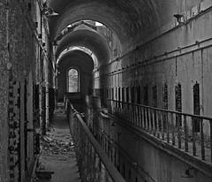 Hallway (scottnj) Tags: bw abandoned philadelphia blackwhite state pennsylvania pg explore prison pa jail eastern catwalk decayed penitentiary supershot explored scottnj
