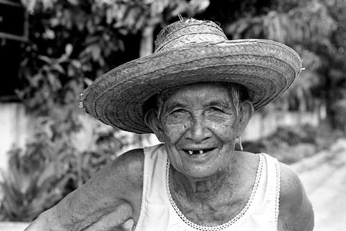 people blackandwhite film portraits thailand women faces elderly kodaktrix nikonfm2n nikonaf50mmf14 fm2testroll10164af50mmf14trix oldwomanwithstrawhat