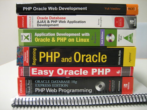 A picture of a stack of books about Oracle and PHP