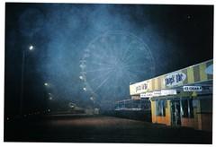 (Steven Barchus) Tags: street film beach wheel fog night 35mm lights deluxe ferris olympus boardwalk stylus grainy daytona