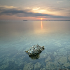 Last light of day (XavierSam) Tags: longexposure sunset espaa sol atardecer mar agua nikon paisaje murcia cielo nubes reflejo marmenor rocas d300 filtros 2011 trasparencias tokina1116 xaviersam singhraydarylbensonnd3revgrad singhraynd3revgrad leebigstopper