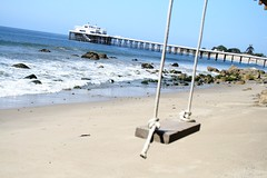 swing and reflect (KarenDinino) Tags: ocean blue beach happy pier sand rocks bright malibu swing shore malibupier artarmy