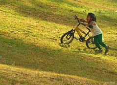Carefree (Inkblots) Tags: boy portrait people bike happy child space philippines olympus zuiko myfaves metromanila pinoycentric filipinochild olympuse510 dingfuellos thefilipinochild larawangpinoy inkblots mypersonalfaves dingfaves