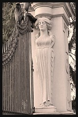 Caryatid At Entrance Gate: Roseland Park Cemetery--Berkley MI (pinehurst19475) Tags: sculpture cemetery architecturaldetail michigan entrance tint woodward berkley caryatid woodwardavenue architecturaldetails femalefigure sculpturalrelief cemeteryart mihistoricsite roselandpark roselandparkcemetery woodwardsights