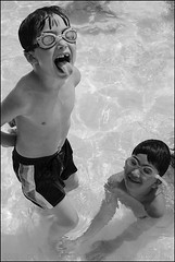 Kids (The Voice of Eye) Tags: boy two portrait people usa goofy sport swimming children outdoors photography couple action humor goggles bodylanguage maryland columbia portraiture editorial joyful playful confident delightful ramsey greyscale poolparty sociology humaninterest inyourface keon cmyk lighthearted irreverent actuality environmentalportraiture craigmorse culturesubculture blackandwhiteblackandwhitebw blancoynegroblancoynegro thevoiceofeye neroebianconeroebianco noiretblancnoiretblanc pretoebrancopretoebranco schwarzesundweischwarzesundwei zwarteenwitzwarteenwit columbiamarylandmd