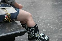 British Fashion (Foucalt) Tags: england london girl daisies bench legs boots britain skirt bumblebee thighs british knee britishmuseum wellies miniskirt rubberboots