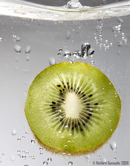 The kiwi dive - high speed flash photography (RichardDumoulin) Tags: water fruits speed photography high underwater flash richard kiwi dumoulin
