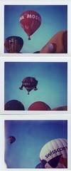 Ma si pu ascendere in virt di una forza che  discendente___Ferrara Balloons Festival (Ilaria ) Tags: polaroid colore toycamera cielo ferrara 669 mongolfiere baloonfestival colorpackii type100film