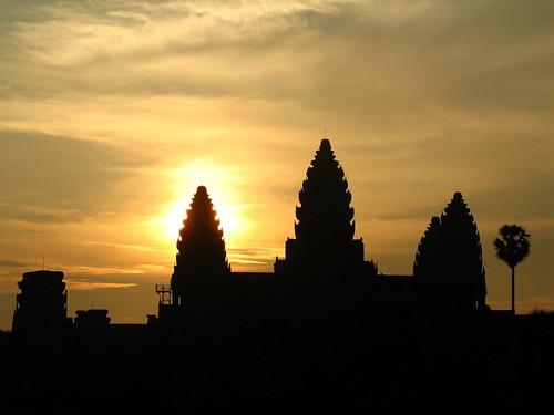 Sun behind Angkor Wat
