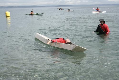 Mckinley rolling the cardboard kayak