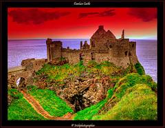Dunluce Castle (Irishphotographer) Tags: ireland sunset sea art history water sunshine stone landscape rocks eire homestead celtic sureal irishart kinkade dunlucecastle beautifulireland imagesofireland picturesofireland pentaxk20d earlyireland kimshatwell irishphotographe