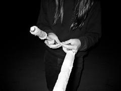 (tao kitamoto) Tags: blackandwhite bw white black night contrast digital dark hair person sticks darkness torches