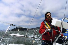 Vorderbrueggen at the helm of a sailboat in the San Francisco Bay