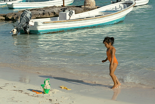 little girl playing in water at Akumal Beach, Mayan Riviera, Mexico