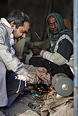 Hard work (aZ-Saudi) Tags: work arabic explore heat saudi arabia worker spark ksa smithy alhasa عامل صناعة عمال arabin ِarabs
