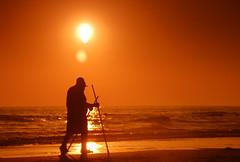 Stroll (golan) Tags: sunset sea people reflection beach june walking sticks sand 2008 chipiona cokin d40 nikon18200mm
