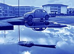 Adiós al surrealismo antoniano (CUSQUENIAN) Tags: auto blue reflection peru southamerica azul vw postes lluvia agua para cusco beetle biblioteca cielo nubes reflejo andes escarabajo soe despedida broom wather unu sudamerica educacion ande escoba charco canchas yaku qosqo canchitas univesidad platinumphoto goldstaraward cusquenian ramiromoreyraportilla unsaac perayoq phuyu perayoc anqha ankash