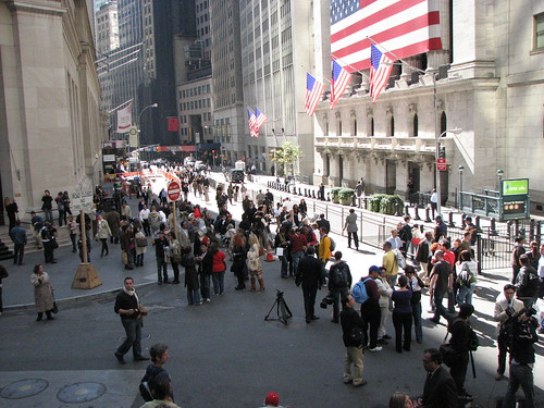 View from steps of Federal hall of crowds and security outside stock exchange