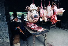 the butcher shop (linh.ngan) Tags: shop pig market pork butcher heo hagiang minoritypeople mountainarea vietbestphoto