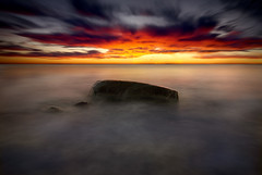 ocean stone sunrise (H o g n e) Tags: ocean longexposure autumn sea sky cloud seascape motion fall beach water norway rock stone clouds sunrise landscape coast landscapes carved solitude waves seascapes wind dusk horizon smooth shoreline wave glacier erosion pebble shore silence glaciers pebblebeach geology oslofjord archipelago vestfold breakingwaves carvedstone carvedrock smoothwater smoothsurface smoothstone slagentangen bildekritikk smoothrock pprowinner vertorama silkwater