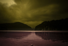 A bavarian lake (manganite) Tags: red sky mountain lake reflection topf25 yellow clouds digital germany dark landscape geotagged bayern bavaria nikon europe mood tl atmosphere symmetry d200 nikkor dslr toned vignette hohenschwangau alpsee schwangau 18200mmf3556 utatafeature manganite nikonstunninggallery repost1 date:year=2008 date:month=september date:day=19 geo:lat=47553327 geo:lon=10735434 format:ratio=32 format:orientation=landscape repost2 repost3