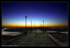 A Walk In Tartous (Falcon EyE) Tags: road nightphotography bridge blue sunset sea sky stilllife abstract art nature night dark landscape harbor boat fishing fisherman nikon bravo perfect colorful sailing peace photographer spectrum outdoor horizon middleeast dramatic quay ciel citylights syria float dri hdr  syrien syrie aplus  tartous 18135  lowlightphotography d80  mywinners nikond80 aplusphoto darknightphotography waseemasmar seaacape     photosfromsyria photosfromlattakia fotodilattakia