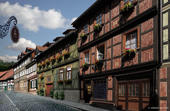 COBBLED STREET  (GERMANY - BLANKENBURG) (KAROLOS TRIVIZAS) Tags: germany thuringia oldhouses blankenburg flowerpots cobbledstreet digitalcameraclub blinkagain