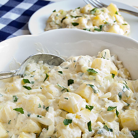 American Potato Salad made with cooked cubed potatoes, mayonnaise, onion, and celery