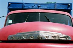 Volvo (Mark Waldron) Tags: morocco essaouira contax g2 fujicolor 200asa 35mm red volvo truck zeiss planar 45mm f2 film old badge