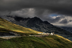 furka (crazyhorse_mk) Tags: road light shadow sky mountains alps nature rock clouds canon landscape switzerland pass meadow peak summit alp soundtrack uri furka furkapass soundtracked sigma1770 spectacularswiss 400d klaiber carptree titansclashaggressivelytokeepanevenmore