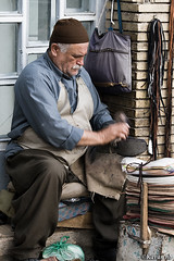 The shoemaker (kavan.) Tags: portrait man canon shoe iran market streetphotography brush iranian bazaar job shoemaker kurdistan kurdish kurd sanandaj bootblack kavan 400d 70200lf4is