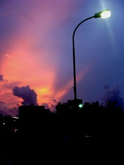 Night taking over the day (Dhimee) Tags: street light orange lamp night day purple