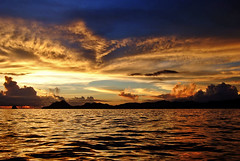 Sailing on sunset (jendayee) Tags: sunset sea sky rock clouds evening warm waves sailing martinique