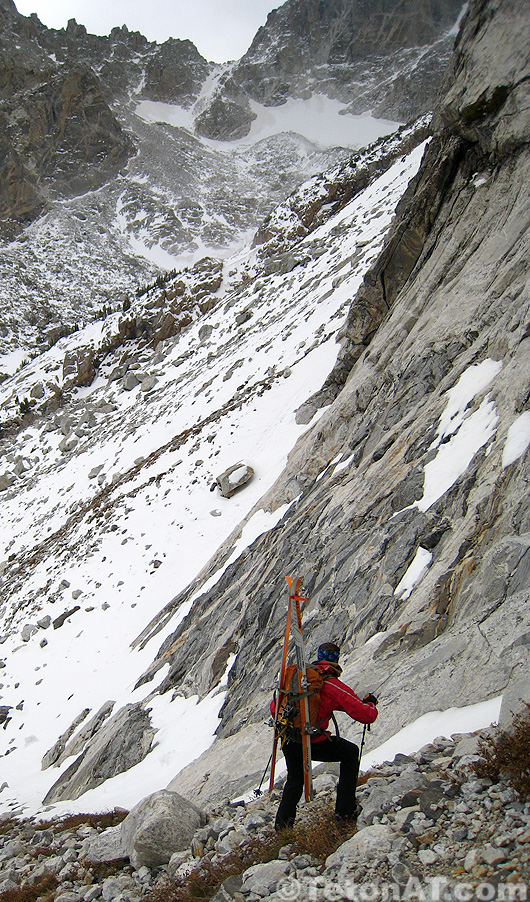 downclimbing towards the cave couloir