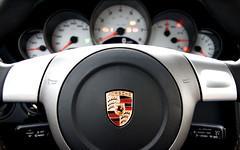 Porsche Cockpit - Widescreen (Peter Gorges) Tags: desktop wallpaper emblem zoom bokeh background widescreen 911 d70s 1600 porsche carrera 997 desktopbackground 2560