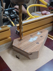 We used a drill press to drill the peg holes to be perpendicular to the surface of the peghead.