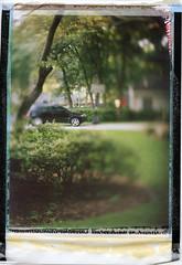 Fuji FP-100C45 (heart_of_au) Tags: color film car tampa print polaroid movement bush fuji tampabay florida bokeh lawn suburbia shift instant 4x5 suburb positive rise suv tilt largeformat speedgraphic tiltshift instantfilm templeterrace fp100c fp100c45 aeroektar kodakaeroektar