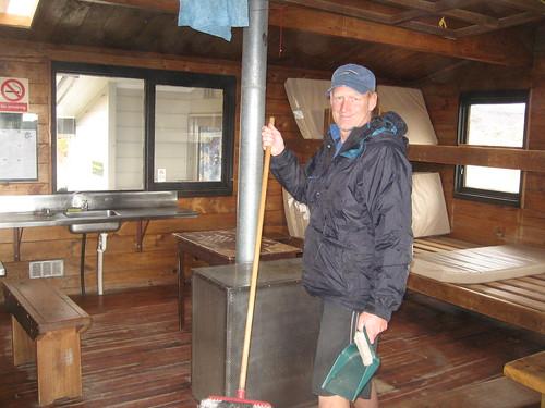 Peter sweeps the hut - Oturere