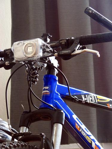 Fujifilm FinePix F100fd taped and gorillapod-ed to bike