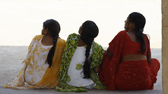 eyes on the skies (vbsuresh) Tags: red india green up yellow hair back women sitting looking fort golkonda hyderabad saree